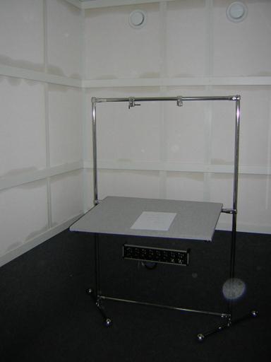Мы сделали стол для диктора. Смысл стола - отсутствие отражающих поверностей (трубы засыпаны песком, плоскоть - рамки обтянута тканью).